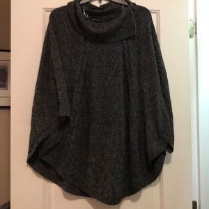 Turtleneck poncho sweater with sleeves